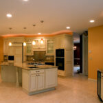 antiqued-cabinets-gold-granite-tops-01