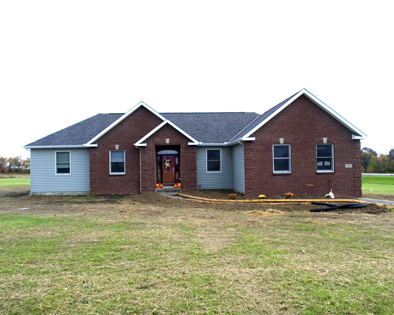 Brick and siding ranch home njw construction for Brick ranch home additions